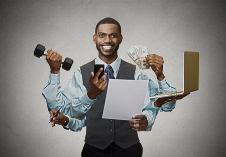 Foto de Multitasking happy business man isolated on grey wall background. Busy life of company manager corporate executive. Many errands concept - Imagen libre de derechos