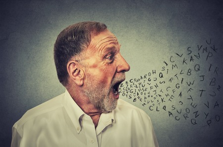 Photo pour Man talking with alphabet letters coming out of his mouth. Communication, information, intelligence concept - image libre de droit