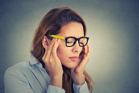 Photo for Portrait stressed young business woman having headache - Royalty Free Image