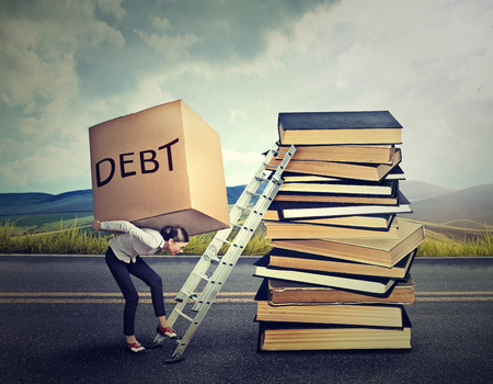 Photo pour Student loan debt concept. Young woman with heavy box full of debt carrying it up the education ladder - image libre de droit