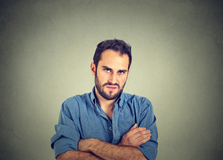 Closeup portrait of angry young man, about to have nervous breakdown, isolated on gray wall background. Negative human emotions facial expression feelings attitude