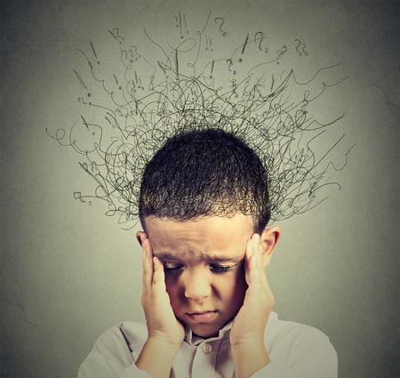 Foto de Closeup sad boy with worried stressed face expression looking down with brain melting into lines question marks. Obsessive compulsive, adhd, anxiety disorders concept - Imagen libre de derechos