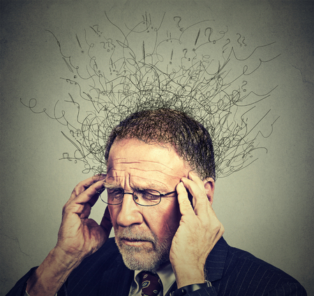 Foto de Closeup sad senior elderly man with worried stressed face expression looking down with brain melting into lines question marks. Obsessive compulsive, adhd, anxiety disorders concept - Imagen libre de derechos