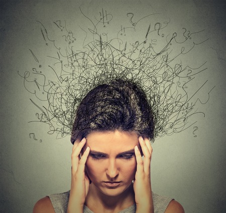 Foto de Closeup sad young woman with worried stressed face expression and brain melting into lines question marks. Obsessive compulsive, adhd, anxiety disorders - Imagen libre de derechos