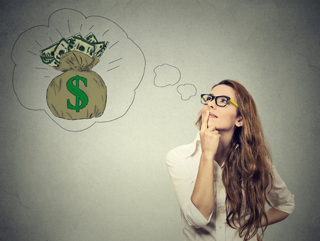 Foto de Woman dreaming of financial success - Imagen libre de derechos