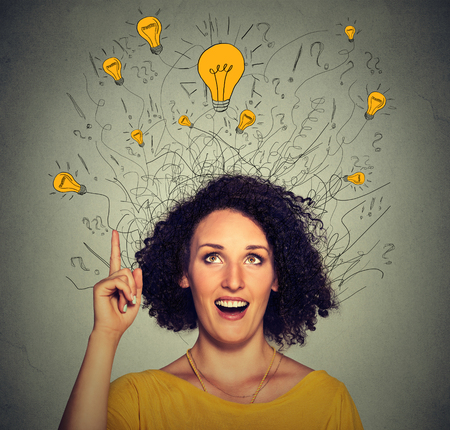 Photo pour Closeup excited woman with many ideas light bulbs above head looking up pointing finger up isolated on gray wall background. Eureka creativity concept - image libre de droit