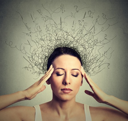 Foto de Closeup young woman with worried stressed face expression eyes closed trying to concentrate with brain melting into lines question marks deep thinking. Obsessive compulsive, adhd, anxiety disorders - Imagen libre de derechos