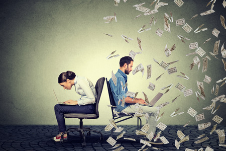 Photo for Employee compensation economy concept. Woman working on laptop sitting next to young  man under money rain. Pay difference concept. - Royalty Free Image