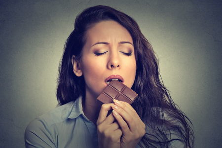 Foto per Beautiful woman eating chocolate - Immagine Royalty Free