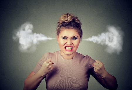 Foto de Closeup portrait angry young woman blowing steam coming out of ears, about to have nervous atomic breakdown screaming isolated black background. Negative human emotion face expression feeling attitude - Imagen libre de derechos