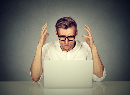 Photo for Stressed man working on computer. Negative human emotion face expression - Royalty Free Image