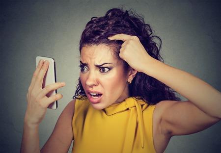 Foto de Closeup unhappy upset woman surprised she is losing hair has receding hairline. Human face expression emotion. Beauty hairstyle concept - Imagen libre de derechos