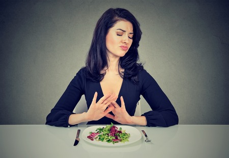 Photo pour Young woman hates vegetarian diet - image libre de droit