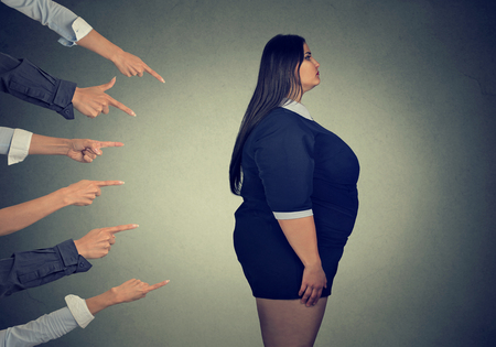 Photo for Many fingers pointing at fat woman - Royalty Free Image