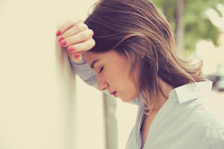 Foto de portrait stressed sad young woman outdoors. City urban life style stress - Imagen libre de derechos