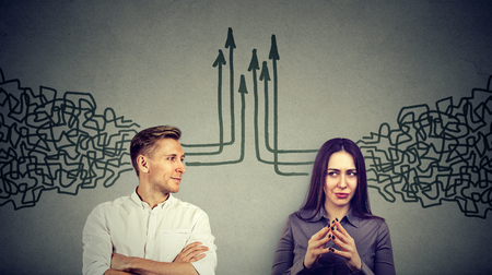 Photo pour Side profile of a young man and woman looking at each other getting their thoughts together isolated on gray wall background - image libre de droit