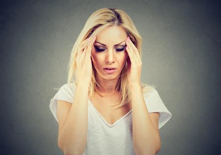 Photo pour Closeup portrait sad young beautiful woman with stressed face expression looking down - image libre de droit