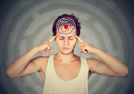 Foto de Problem solution concept. Young puzzled man isolated on gray wall background - Imagen libre de derechos