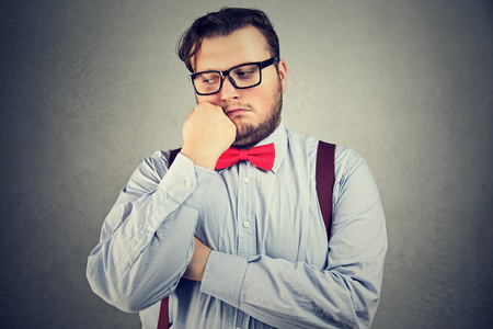 Photo pour Young man with overweight posing in bow-tie and eyeglasses looking sad.  - image libre de droit