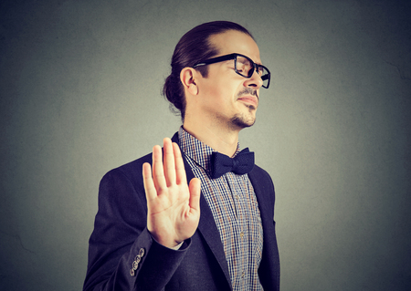Photo for Young elegant man in eyeglasses stopping with hand while looking annoyed and insulted.  - Royalty Free Image
