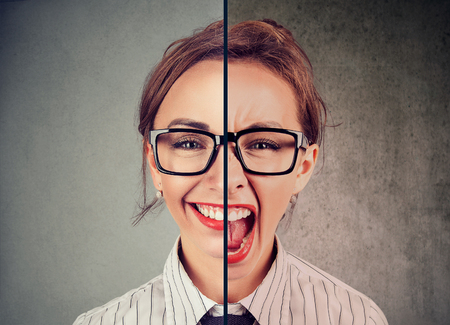 Foto de Bipolar disorder concept. Young woman with double face expression isolated on gray background - Imagen libre de derechos