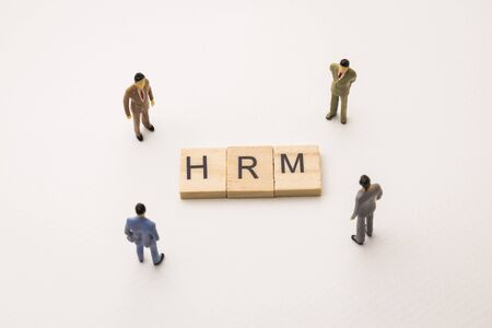 Photo for Miniature figures businessman : meeting on hrm letters by wooden block word on white paper background, in concept of business and corporation - Royalty Free Image