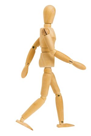 Photo pour wooden figure in walking step action isolated on white background, Include clipping path. - image libre de droit