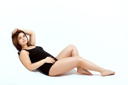 Photo pour Beautiful model size plus in a black swimsuit. - image libre de droit