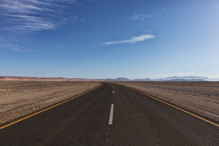 Photo for Asphalt road crossing the Namibia Desert on the way to Sossusvlei. - Royalty Free Image