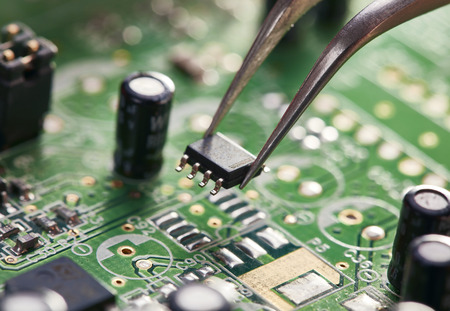 Foto de Assembling a circuit board. Technological background - Imagen libre de derechos