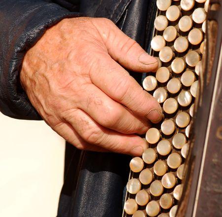 Old man play retro accordion