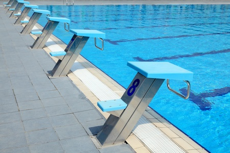 Detail from open air sports competition swimming pool - starting places