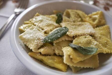 Photo for Ravioli pasta with butter and sage - Royalty Free Image