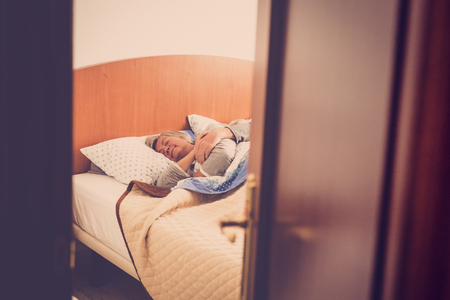 Photo for adult aged couple sleep at the bedroom at home, indoor daily scene for sweet love forever. retro look filter. hidden scene. sweetness and elderly - Royalty Free Image
