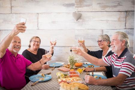 Photo pour celebrating dinner for two couples and caucasian men and women - image libre de droit