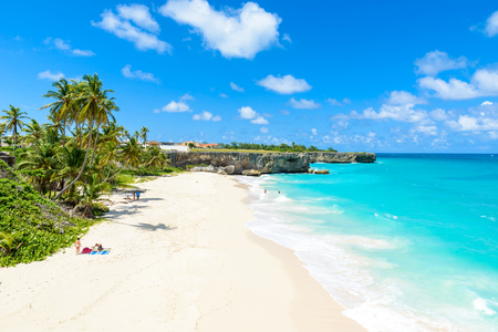 Photo for Bottom Bay, Barbados - Paradise beach on the Caribbean island of Barbados. Tropical coast with palms hanging over turquoise sea. Panoramic photo of beautiful landscape. - Royalty Free Image