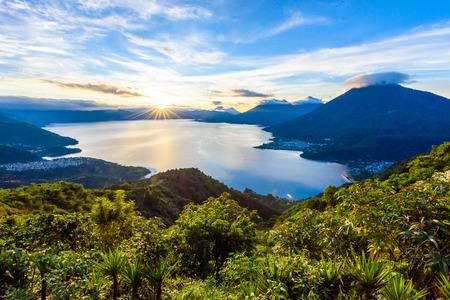 Photo for Sunrise in the morning at lake Atitlan, Guatemala - amazing panorama view to the volcanos San Pedro, Toliman and Atitlan - Royalty Free Image