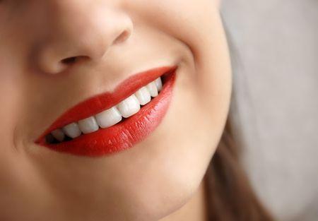 young girl beautiful red lips smiling closeup