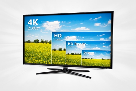 Foto de 4K television display with comparison of resolutions  - Imagen libre de derechos