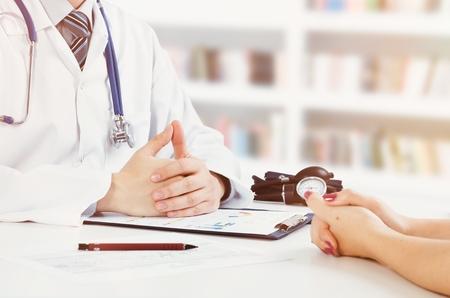 Foto de Doctor and patient medical consultation. doctor patient health care office desk stethoscope medical concept - Imagen libre de derechos