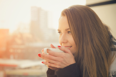 Photo for Woman drinking coffee or tea with cup on the balcony. coffee woman happy sun morning tea life beautiful concept - Royalty Free Image
