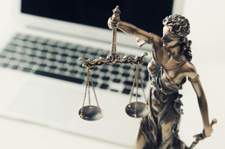 Photo pour Justice and law concept in technology. justice computer themis scale weight courtroom laptop technology composition - image libre de droit