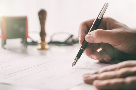 Foto de Notary signs legal contract. Businessman working in office. notary public lawyer desk attorney office law official concept - Imagen libre de derechos