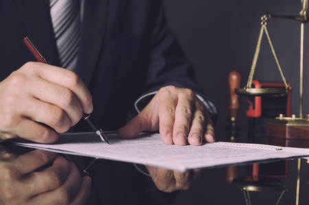 Foto de Attorney in suit working in office. law lawyer pen business man notary scale concept - Imagen libre de derechos