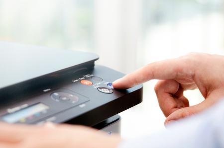 Photo pour Hand press button on panel of printer. printer scanner laser office copy machine supplies start concept - image libre de droit
