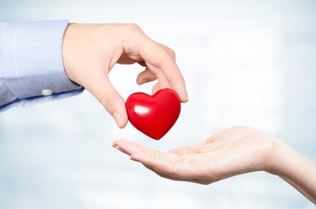 Foto de Hand holding red heart. Health care medicine and life concept - Imagen libre de derechos