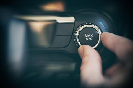 Foto de Air conditioning button inside a car. Cold, heat control concept - Imagen libre de derechos