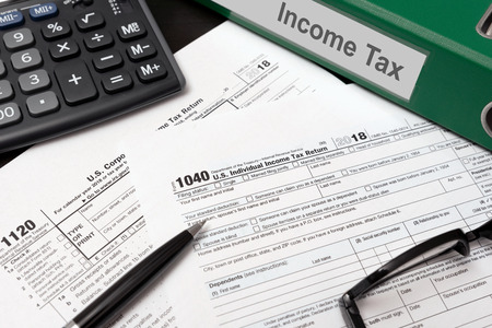 Foto per U.S. Individual income tax return. USA tax forms on desk - Immagine Royalty Free