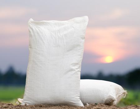 Foto de Agriculture, Fertilizer bag over sunrise background - Imagen libre de derechos
