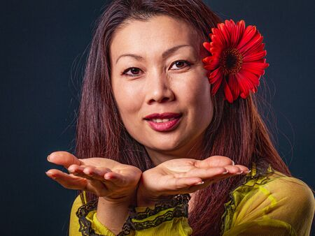 Photo for Portrait of middle aged Asian beautiful happy woman, looking at camera and making a hand gesture. - Royalty Free Image